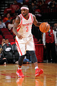 Ty Lawson of the Houston Rockets dribbles the ball against the New Orleans Pelicans during a preseason game on October 19 2015 at the Toyota Center...