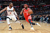 Ty Lawson of the Houston Rockets drives to the basket against Chris Paul of the Los Angeles Clippers during the game on January 18 2016 at STAPLES...