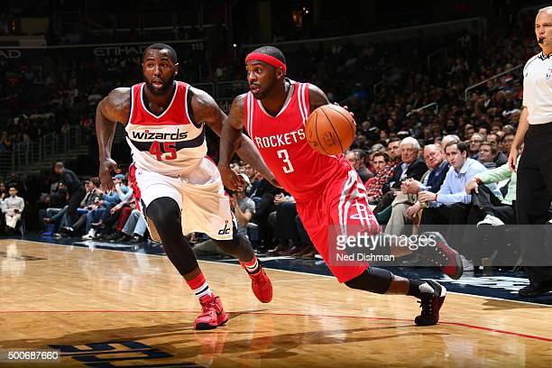 Ty Lawson of the Houston Rockets drives to the basket against DeJuan Blair of the Washington Wizards on December 9 2015 at Verizon Center in...