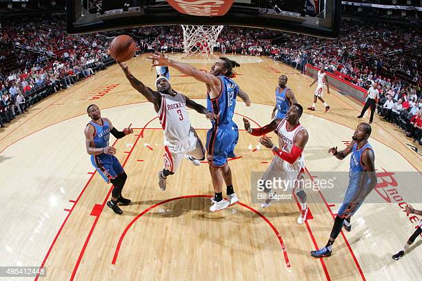 Ty Lawson of the Houston Rockets goes to the basket against the Oklahoma City Thunder on November 2 2015 at the Toyota Center in Houston Texas NOTE...