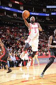 Ty Lawson of the Houston Rockets goes to the basket against the Miami Heat on October 17 2015 at the Toyota Center in Houston Texas NOTE TO USER User...