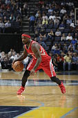 Ty Lawson of the Houston Rockets handles the ball against the Memphis Grizzlies during a preseason game on October 6 2015 at FedExForum in Memphis...