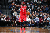 Ty Lawson of the Houston Rockets handles the ball during the game against the Brooklyn Nets on December 8 2015 at Barclays Center in Brooklyn New...