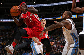 Ty Lawson of the Houston Rockets looks to basket as he tries to get off a shot against Jameer Nelson of the Denver Nuggets at Pepsi Center on...