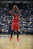 Ty Lawson of the Houston Rockets shoots the ball against the Memphis Grizzlies during a preseason game on October 6 2015 at FedExForum in Memphis...