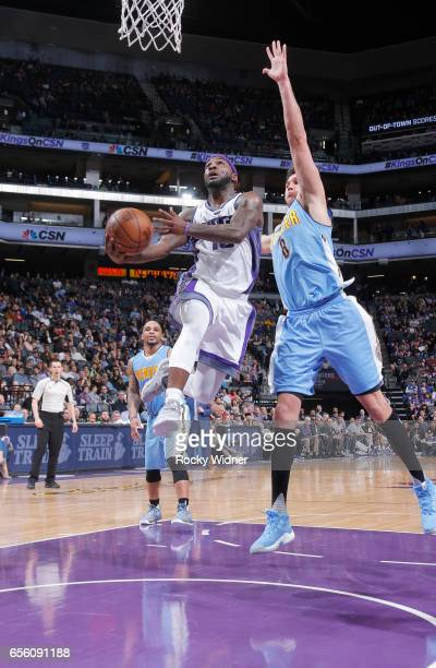 Ty Lawson of the Sacramento Kings goes up for the shot against Danilo Gallinari of the Denver Nuggets on March 11 2017 at Golden 1 Center in...