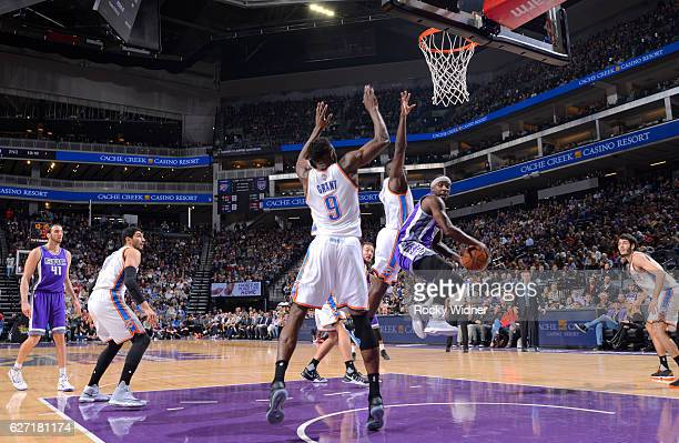 Ty Lawson of the Sacramento Kings passes against Jerami Grant of the Oklahoma City Thunder on November 23 2016 at Golden 1 Center in Sacramento...