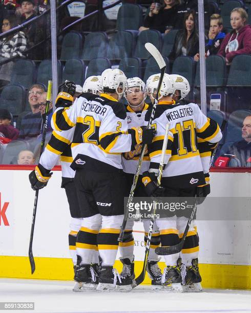 Ty Lewis of the Brandon Wheat Kings celebrates after scoring against the Calgary Hitmen during a WHL game at the Scotiabank Saddledome on October 8...
