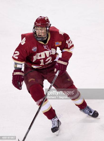 Ty Loney of the Denver Pioneers looks for the puck against the MassachusettsAmherst Minutemen during NCAA hockey action at the Mullins Center on...