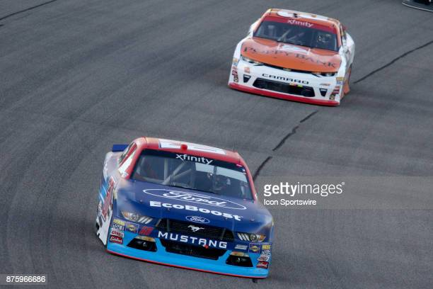 Ty Majeski driver of the Ford EcoBoost Ford and Daniel Hemric driver of the Smokey Mountain Herbal Snuff Chevy in turn one during the EcoBoost 300 at...