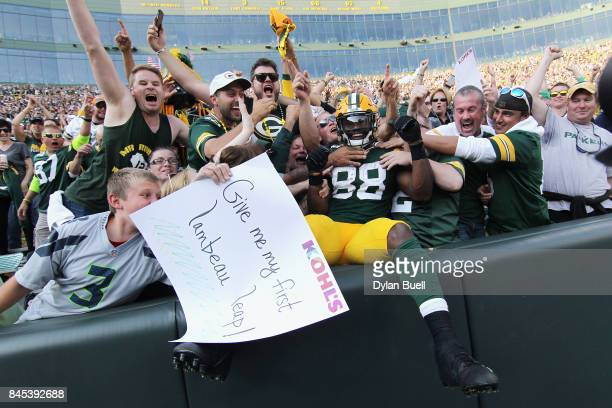 Ty Montgomery of the Green Bay Packers celebrates with fans after scoring a 6yard rushing touchdown during the third quarter against the Seattle...