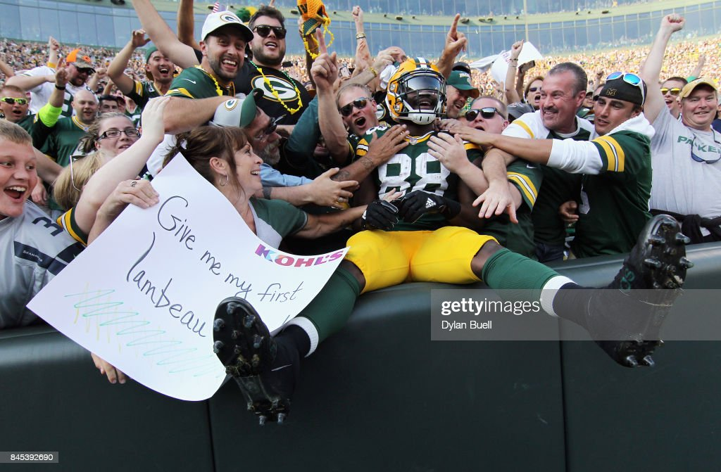 Ty Montgomery #88 of the Green Bay Packers celebrates with fans after scoring a 6-yard rushing touchdown during the third quarter against the Seattle Seahawks at Lambeau Field on September 10, 2017 in Green Bay, Wisconsin.