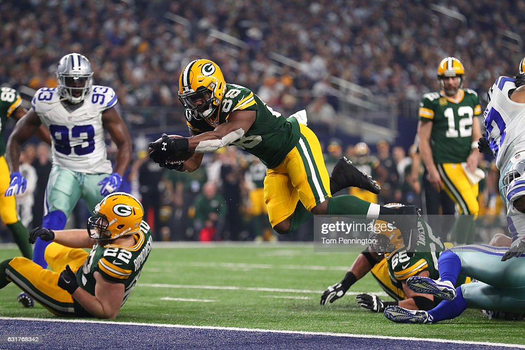 Ty Montgomery #88 of the Green Bay Packers dives into the end zone to score a touchdown during the second quarter against the Dallas Cowboys in the NFC Divisional Playoff game at AT&T Stadium on January 15, 2017 in Arlington, Texas.