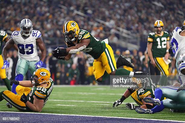 Ty Montgomery of the Green Bay Packers dives into the end zone to score a touchdown during the second quarter against the Dallas Cowboys in the NFC...
