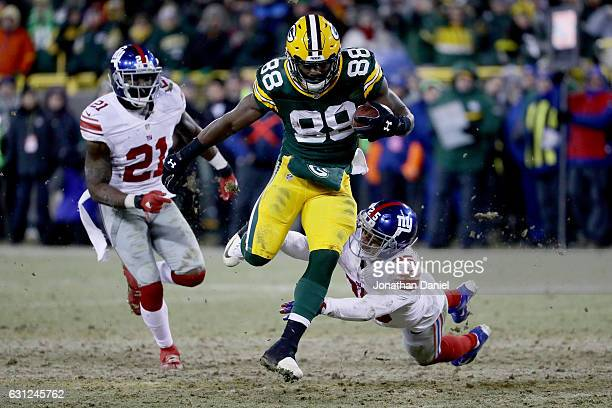 Ty Montgomery of the Green Bay Packers escapes a tackle attempt by Leon Hall of the New York Giants in the fourth quarter during the NFC Wild Card...