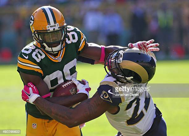 Ty Montgomery of the Green Bay Packers fights off Trumaine Johnson of the St Louis Rams at Lambeau Field on October 11 2015 in Green Bay Wisconsin...