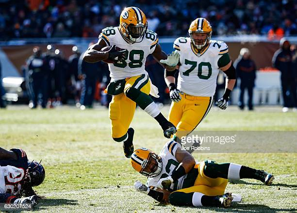 Ty Montgomery of the Green Bay Packers jumps over teammate Richard Rodgers in the second quarter against the Chicago Bears at Soldier Field on...
