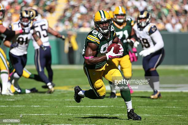 Ty Montgomery of the Green Bay Packers runs the football back 31 yards for a touchdown against the St Louis Rams in the first quarter at Lambeau...