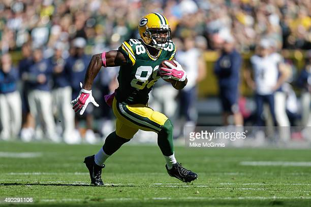 Ty Montgomery of the Green Bay Packers runs the football back for a touchdown against the St Louis Rams in the first quarter at Lambeau Field on...