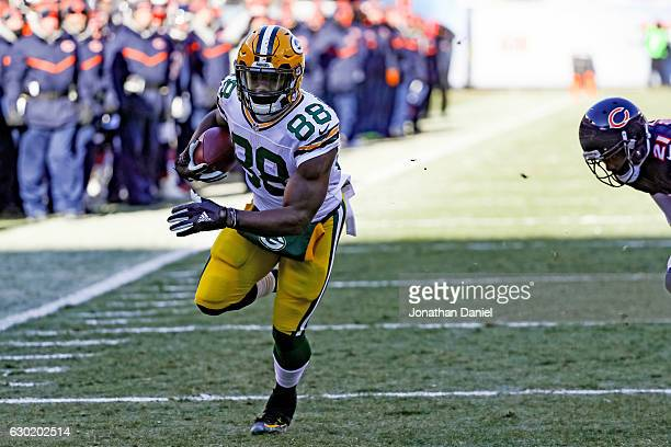 Ty Montgomery of the Green Bay Packers runs the football into the endzone for a touchdown in the first quarter against the Chicago Bears at Soldier...