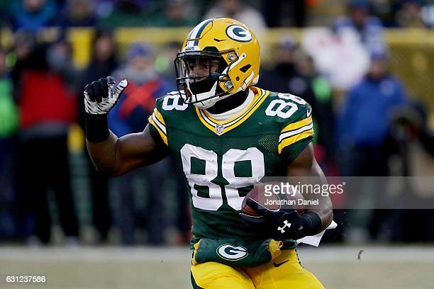 Ty Montgomery of the Green Bay Packers runs with the ball in the first quarter during the NFC Wild Card game against the New York Giants at Lambeau...