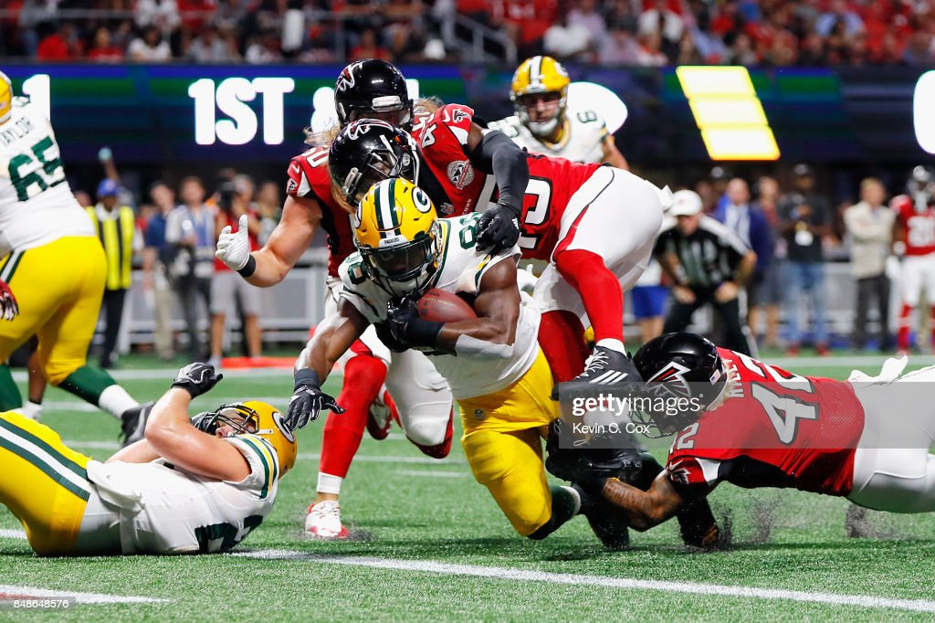 Ty Montgomery #88 of the Green Bay Packers rushes for a 1-yard touchdown during the first quarter against the Atlanta Falcons at Mercedes-Benz Stadium on September 17, 2017 in Atlanta, Georgia.