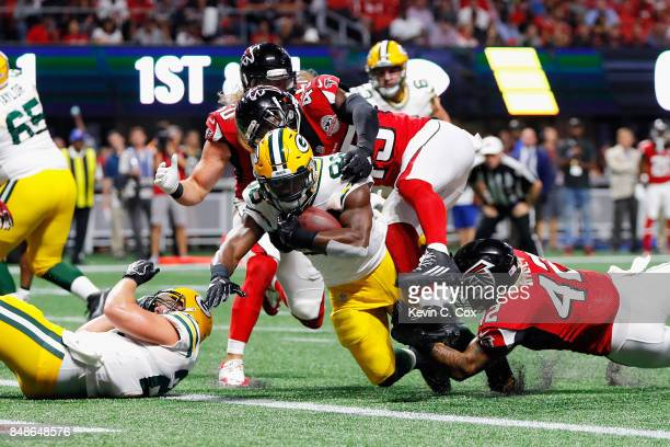 Ty Montgomery of the Green Bay Packers rushes for a 1yard touchdown during the first quarter against the Atlanta Falcons at MercedesBenz Stadium on...
