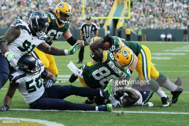 Ty Montgomery of the Green Bay Packers scores a 6yard rushing touchdown during the third quarter against the Seattle Seahawks at Lambeau Field on...