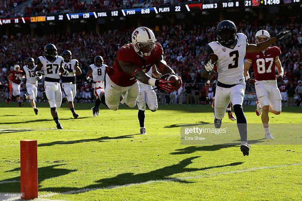 Ty Montgomery #7 of the Stanford Cardinal dives in for his fourth touchdown against the California Golden Bears at Stanford Stadium on November 23, 2013 in Palo Alto, California.