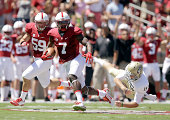 Ty Montgomery of the Stanford Cardinal goes past Colby Wadman of the UC Davis Aggies on his way to returning a punt for a touchdown at Stanford...