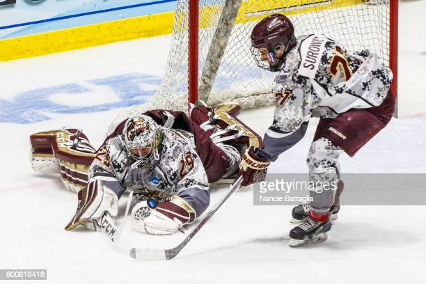 Ty Reichenbach of Norwich University makes a save during the Division lll Men's Ice Hockey Championship held at the Utica Memorial Auditorium on...