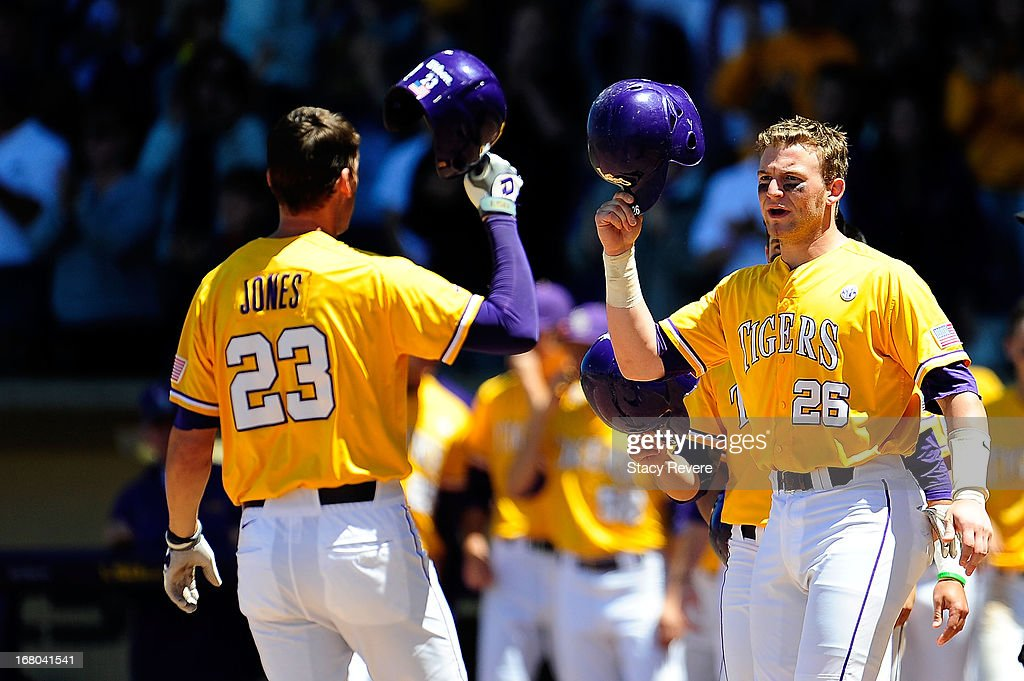 Ty Ross #26 of the LSU Tigers greets JaCoby Jones #23 following a home run during a game against the Florida Gators at Alex Box Stadium on May 4, 2013 in Baton Rouge, Louisiana.