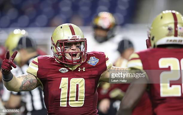 Ty Schwab of the Boston College Eagles celebrates a third quarter touchdown on a fumble recovery during the game against the Maryland Terrapins at...