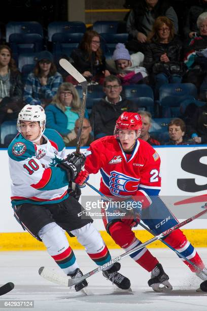 Ty Smith of the Spokane Chiefs checks Nick Merkley of the Kelowna Rockets on February 17 2017 at Prospera Place in Kelowna British Columbia Canada
