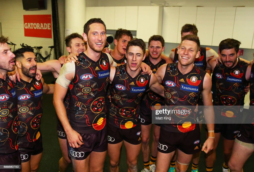 Ty Vickery, James Cousins and Dallas Willsmore of the Hawks celebrate victory with team mates and sing the team song after the round 10 AFL match between the Sydney Swans and the Hawthorn Hawks at Sydney Cricket Ground on May 26, 2017 in Sydney, Australia.