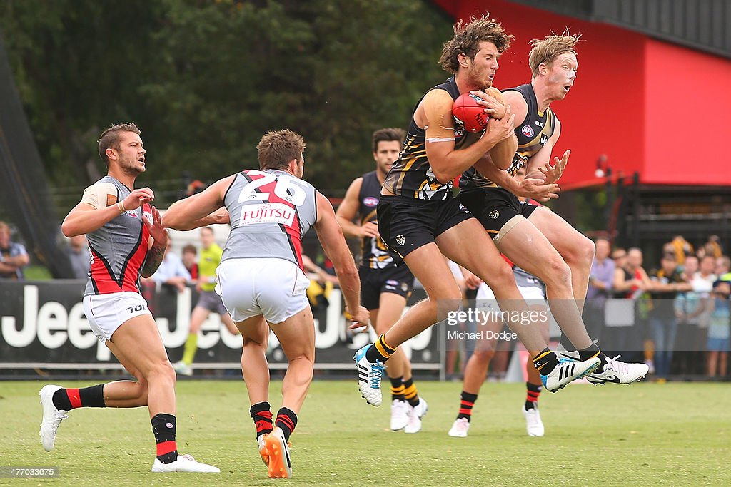 Ty Vickery of the Tigers marks the ball next to <a gi-track='captionPersonalityLinkClicked' href=/galleries/search?phrase=Jack+Riewoldt&family=editorial&specificpeople=2327975 ng-click='$event.stopPropagation()'>Jack Riewoldt</a> against Tayte Pears (L) and Cale Hooker of the Bombers during an AFL Practice Match between the Richmond Tigers and the Essendon Bombers at Punt Road Oval on March 7, 2014 in Melbourne, Australia.