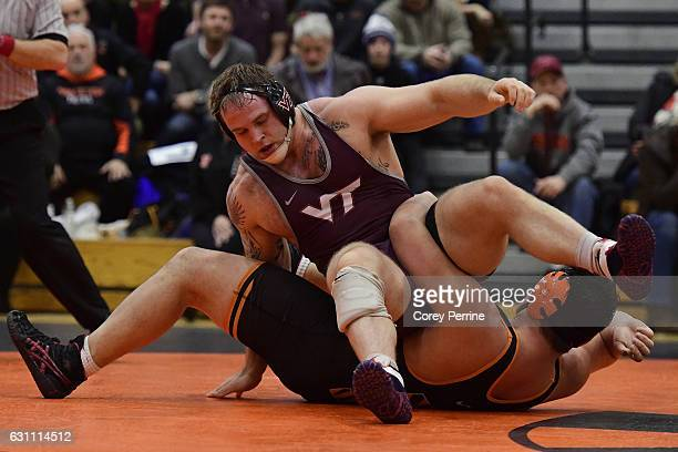 Ty Walz of the Virginia Tech Hokies scrambles for balance over Ray O'Donnell of the Princeton Tigers at Dillon Gym on January 6 2017 in Princeton New...