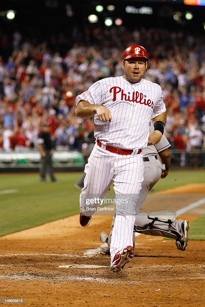 <a gi-track='captionPersonalityLinkClicked' href=/galleries/search?phrase=Ty+Wigginton&family=editorial&specificpeople=211533 ng-click='$event.stopPropagation()'>Ty Wigginton</a> #24 of the Philadelphia Phillies scores a run to tie the game in the bottom of the ninth inning of the game against the Colorado Rockies at Citizens Bank Park on June 20, 2012 in Philadelphia, Pennsylvania. The Phillies won 7-6.