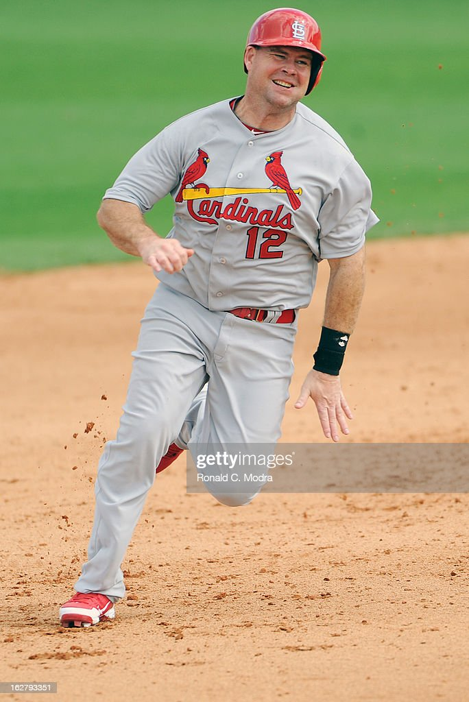 Ty Wigginton #12 of the St. Louis Cardinals runs to third base during a spring training game against the Florida Marlins at Roger Dean Stadium on February 23, 2013 in Jupiter, Florida.