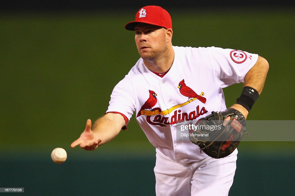 Ty Wigginton #12 of the St. Louis Cardinals tosses the ball to first base for an out against the Cincinnati Reds during the second inning at Busch Stadium on April 29, 2013 in St. Louis, Missouri.