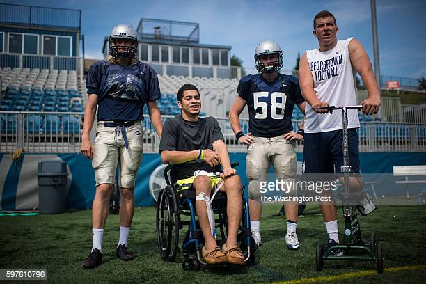 Ty Williams a linebacker for the Georgetown University Hoyas talks with other players and attends practice despite his being in a wheelchair and...