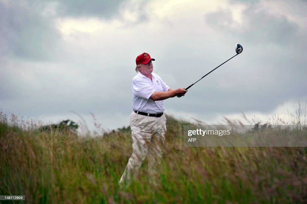 US tycoon Donald Trump plays a stroke as : News Photo