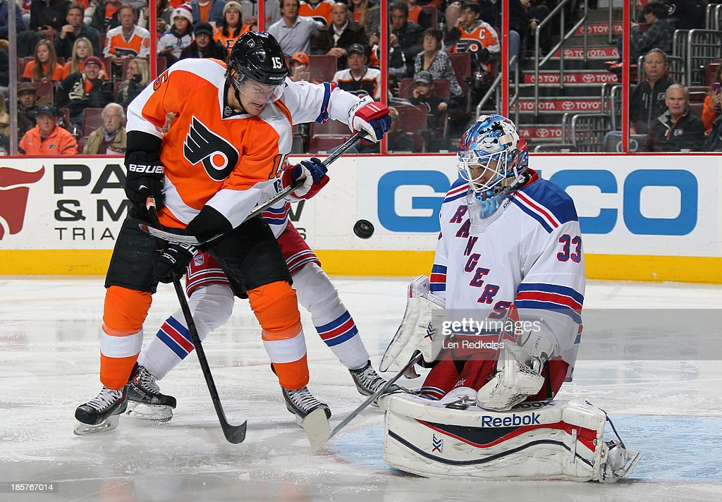 <a gi-track='captionPersonalityLinkClicked' href=/galleries/search?phrase=Tye+McGinn&family=editorial&specificpeople=4604402 ng-click='$event.stopPropagation()'>Tye McGinn</a> #15 of the Philadelphia Flyers battles for position in front of goaltender Cam Talbot #33 of the New York Rangers on October 24, 2013 at the Wells Fargo Center in Philadelphia, Pennsylvania. The Flyers went on to defeat the Rangers 2-1.