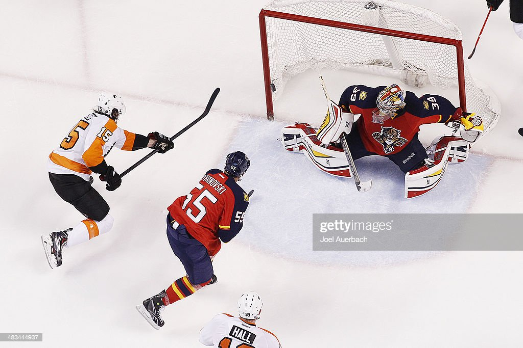 Tye McGinn #15 of the Philadelphia Flyers scores the final goal of the game past Goaltender Dan Ellis #39 of the Florida Panthers in the third period at the BB&T Center on April 8, 2014 in Sunrise, Florida. The Flyers defeated the Panthers 5-2.