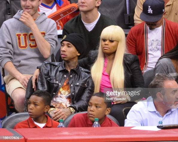 Tyga and Blac Chyna attend a basketball game between the Miami Heat and the Los Angeles Clippers at Staples Center on November 14 2012 in Los Angeles...