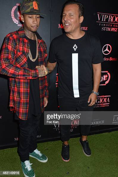 Tyga and Jean Roch Pedri attend the Tyga Live Performance Party at the VIP Room Saint Tropez on August 5 2015 in SaintTropez France