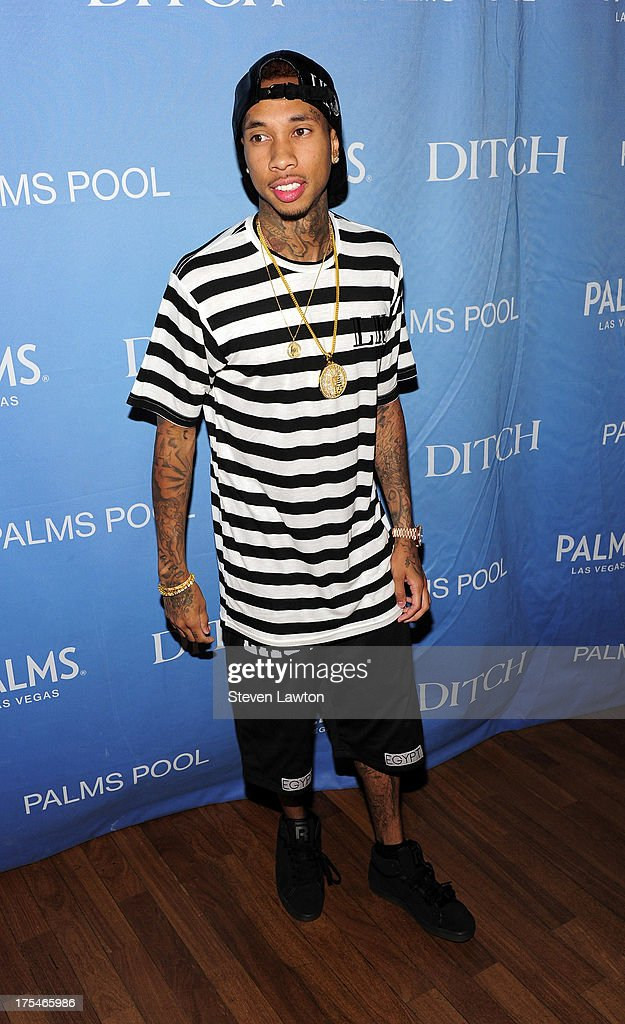 <a gi-track='captionPersonalityLinkClicked' href=/galleries/search?phrase=Tyga&family=editorial&specificpeople=4489457 ng-click='$event.stopPropagation()'>Tyga</a> arrives at 'Ditch Saturdays' at the Palms Casino Resort on August 3, 2013 in Las Vegas, Nevada.