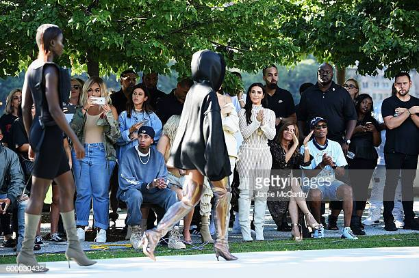 Tyga Kylie Jenner Kendall Jenner Kim Kardashian Carine Roitfeld and Pharrell Williams attend the Kanye West Yeezy Season 4 fashion show on September...