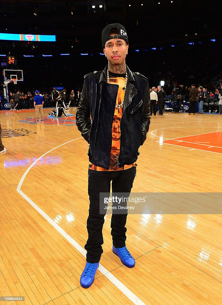 <a gi-track='captionPersonalityLinkClicked' href=/galleries/search?phrase=Tyga&family=editorial&specificpeople=4489457 ng-click='$event.stopPropagation()'>Tyga</a> poses wearing his Reebok T-Raww's before the Brooklyn Nets vs New York Knicks game at Madison Square Garden on January 21, 2013 in New York City.
