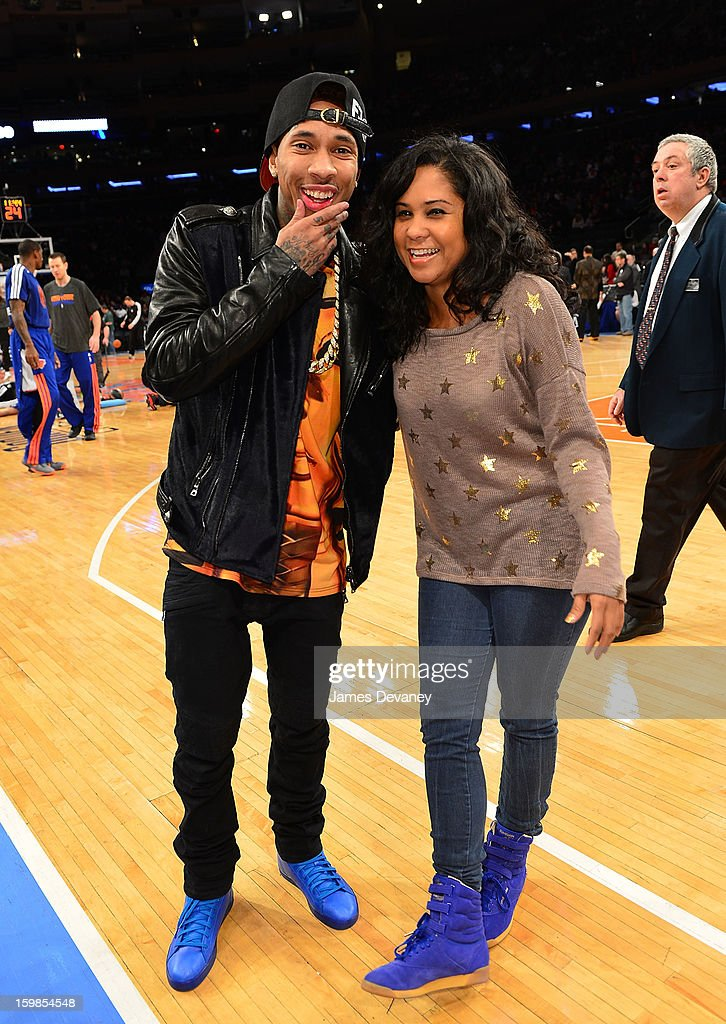 <a gi-track='captionPersonalityLinkClicked' href=/galleries/search?phrase=Tyga&family=editorial&specificpeople=4489457 ng-click='$event.stopPropagation()'>Tyga</a> poses with <a gi-track='captionPersonalityLinkClicked' href=/galleries/search?phrase=Angela+Yee&family=editorial&specificpeople=4443054 ng-click='$event.stopPropagation()'>Angela Yee</a> wearing his Reebok T-Raww's before the Brooklyn Nets vs New York Knicks game at Madison Square Garden on January 21, 2013 in New York City.